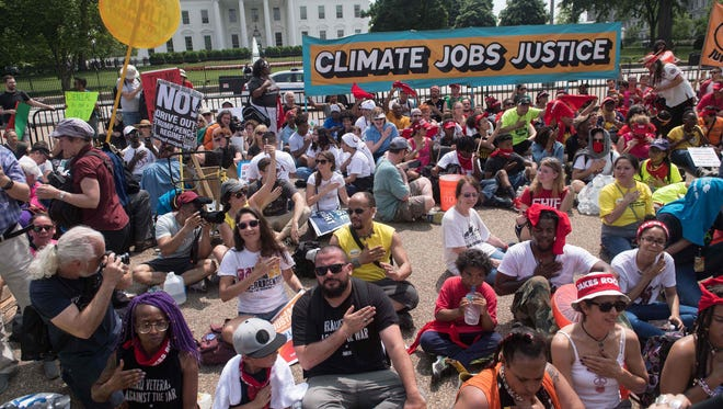 Protesters chant in front of the White House during the People's Climate March in Washington, DC, on April 29, 2017.