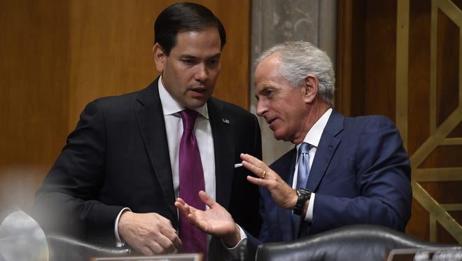 Sen. Marco Rubio (R-Fla.) and Sen. Bob Corker (R-Tenn.) chat Tuesday, May 2, 2017, at at Iowa Gov. Terry Branstad confirmation hearing with the Senate Foreign Relations Committee in Washington, D.C.