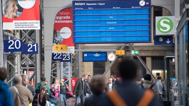 An electronic display calls on travelers to watch the analogue timetable at the main railway station in Frankfurt am Main, western Germany, on May 13, 2017. A fast-moving wave of cyberattacks swept the globe, apparently exploiting a flaw exposed in documents leaked from the U.S. National Security Agency.