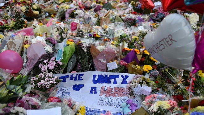 A carpet of flowers and messages lie at St Ann's Square in Manchester, northwest England on May 24, 2017, placed in tribute to the victims of the May 22 terror attack at the Manchester Arena.