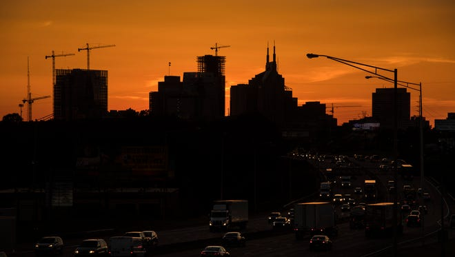 The Nashville skyline glows at sunset May 25, 2017. Nashville is booming. The new people who move to Nashville and can afford the rising prices of housing can find a place to live in or near downtown, the heart of economic activity and jobs. Those who cannot are being pushed farther away from their jobs, community networks, social services and transit options.