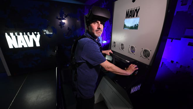 The Navy is using VR to recruit prospective recruits. Ed Baig dons the headset and chest strap to check it all out.
