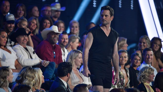 Host Charles Esten wears a romper during one segment of the CMT Music Awards at Music City Center.