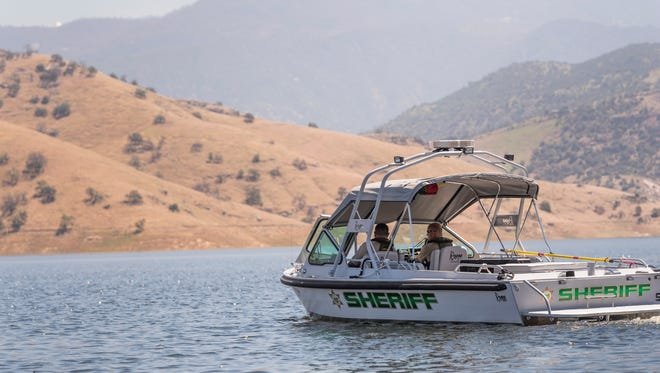 During thestop, deputies witnessed a man and a child, without lifejackets, swimming in deep water more than a 100 feet from shore.