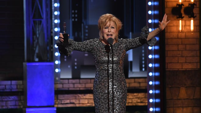 Bette Midler accepts the award for Leading Actress in a Musical for 'Hello, Dolly!' at the 71st Tony Awards at Radio City Music Hall Sunday night.