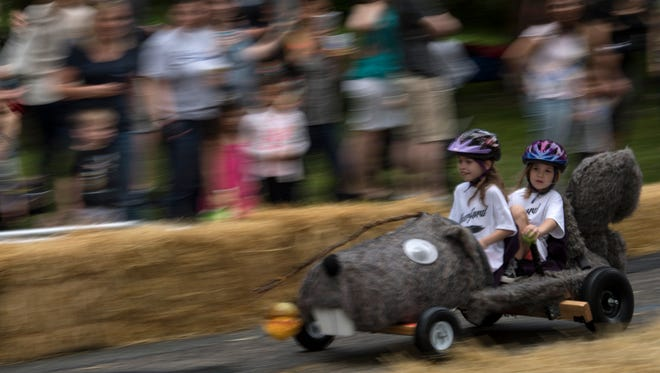 Rutherford holds a downhill derby on Saturday, June 17, 2017.  Micaela Britez, 8, and Grace Kayla,7, race down W. Pierrepont Ave. in their squirrel themed car.