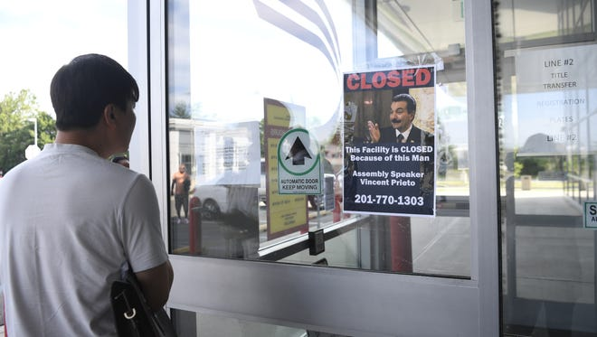 The Department of Motor Vehicles in Lodi is closed, along with every other in the state of New Jersey as the government is shutdown. Flyers blaming Assembly speaker Vincent Prieto were taped to the doors as residents tried to enter the DMV on Monday, July 3, 2017.