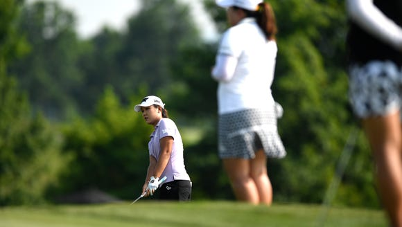Fourth-ranked Lydia Ko, far left, watches her putt