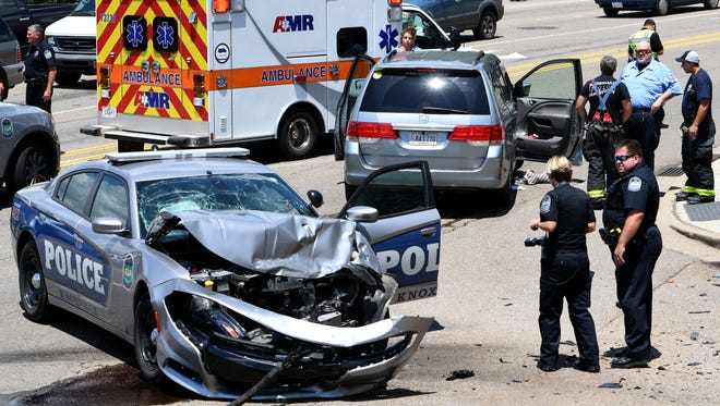 A KPD cruiser responding to a call collided with another vehicle, killing the driver and sending the officer to the hospital Thursday, July 13, 2017. The crash was reported around 12:40 p.m. at the corner of Henley Street and West Summit Hill Drive.