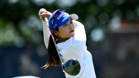 Hye-Jin Choi, 17 of South Korea, tees off at Hole 1 to begin the final round of the U.S. Women's Open at Trump National Golf Club in Bedminster, NJ on Sunday, July 16, 2017.