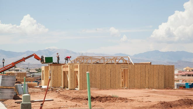 Construction crews continue building homes in Little Valley Wednesday, July 26, 2017. Local governments and city planners discuss the projected increase in population and the potential impacts on the area.