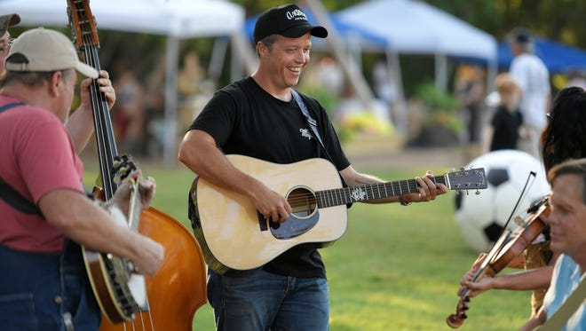 Jason Isbell plays with other musicians including his wife, Amanda Shires, at Leiper's Fork Farmers Market on Thursday, Aug. 3, 2017.