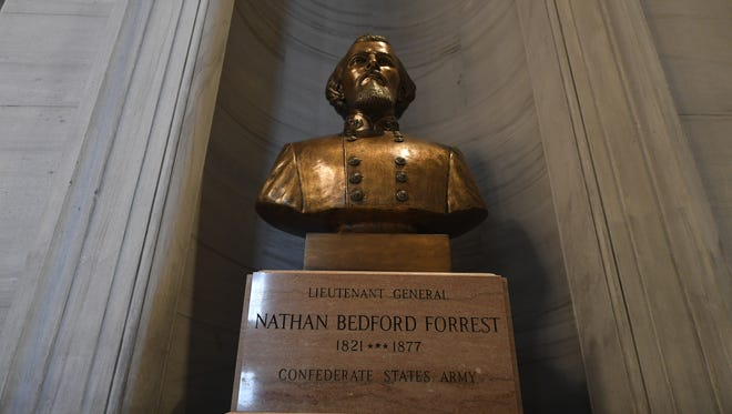 Protesters gather near the office of Tennessee Governor Bill Haslam's office at the Tennessee Capitol to protest a bust of Confederate leader Nathan Bedford Forrest Monday, Aug. 14, 2017