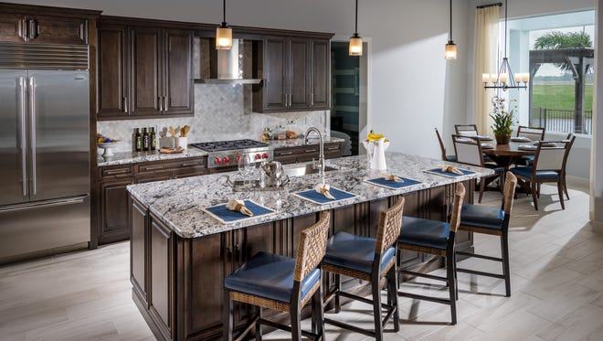 Azure at Hacienda Lakes is offering a 3,171-square-foot quick delivery Aragon Caribbean home, like the one shown, that will be move-in ready this fall.