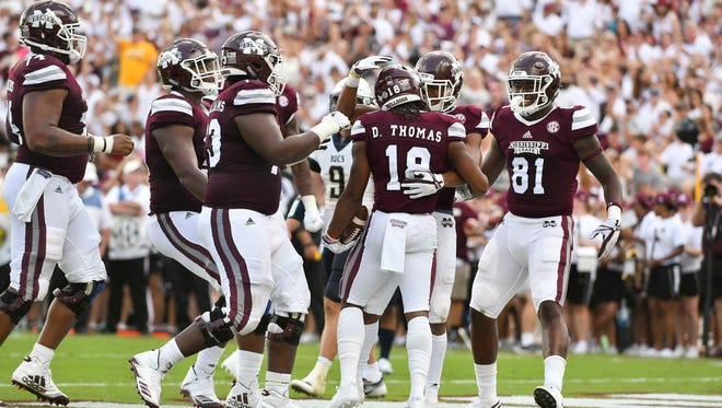 Mississippi State Bulldogs players celebrate after a touchdown during the second quarter of the game against the Charleston Southern Buccaneers at Davis Wade Stadium in Starkville.