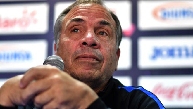 Arena speaks during a press conference Monday ahead of Tuesday's qualifier in Honduras.