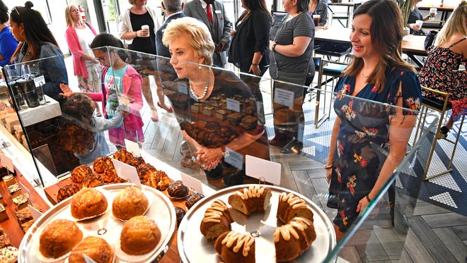 Linda McMahon, head of the U.S. Small Business Administration, leans over to get a better look at some pastries as she visited with Caviar and Bananas owner Margaret Furniss, right, who is a recipient of two SBA-backed loans. Thursday Sept. 7, 2017, in Nashville, TN