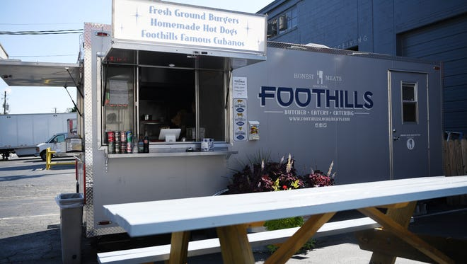 The Foothills Food Truck is permanently located at Hi-Wire Brewing's Big-Top in Biltmore Village.