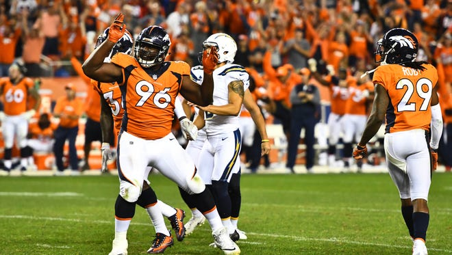 Denver Broncos defensive end Shelby Harris (96) celebrates his blocked field goal attempt by Los Angeles Chargers kicker Younghoe Koo in the fourth quarter at Sports Authority Field at Mile High.