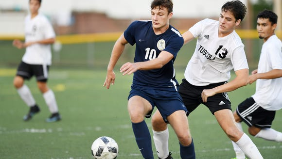 Roberson's Jack Sandstedt runs for the ball in the