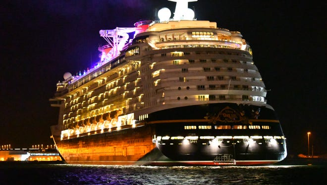 The damaged Disney Dream arrives in Port Canaveral before dawn Monday morning. The stern of the ship was damaged on Sunday while striking a pier in Nassau.