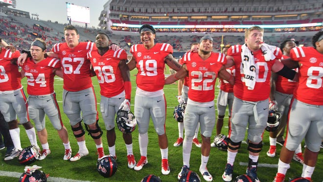 Oct 14, 2017; Oxford, MS, USA; Mississippi Rebels players celebrate after the game against the Vanderbilt Commodores at Vaught-Hemingway Stadium. Mandatory Credit: Matt Bush-USA TODAY Sports