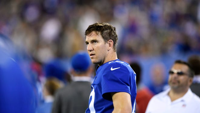 New York Giants quarterback Eli Manning (10) watches the replay of the Seahawks touchdown in the fourth quarter. The Seattle Seahawks defeat the New York Giants 24-7 on Sunday, October 22, 2017 in East Rutherford, NJ.
