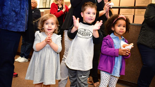 Children celebrate as socks from the nonprofit Knock Knock a Sock are distributed at New Light Baptist Church on Dewey Street in Bloomfield on Wednesday, Oct. 25.