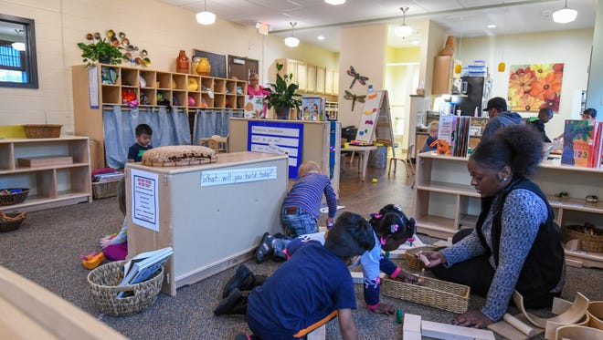Students and teachers speed out around the classroom for play time Monday, Oct. 23, 2017 at the Cincinnati Early Learning Center in Price Hill. Many of the students at CELC are eligible for the Preschool Promise program.