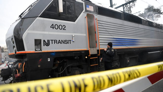A Montclair police officer is the first to respond to the scene of a terrorist situation on the train during an emergency response drill conducted by the New Jersey Transit Police and the Office of Emergency Management (OEM) at the Upper Montclair station in November.