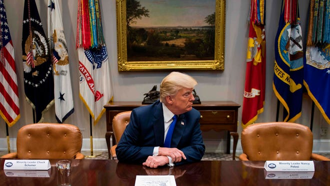 President Trump makes a statement from the Roosevelt Room next to the empty chairs of Senate Minority Leader Chuck Schumer, D-N.Y., and House Minority Leader Nancy Pelosi, D-Calif., after they cancelled their meeting at the White House in Washington, D.C., on Nov. 28, 2017.