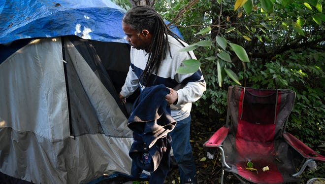 Howard Allen visits his campsite Monday in Nashville. Allen advocates for other homeless people in the city.