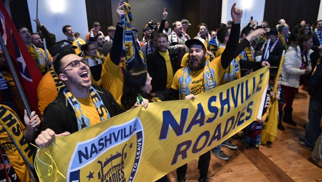 Members of The Roadies, a Nashville SC supporter group, cheer the announcement that the city is getting a Major League Soccer expansion franchise on Dec. 20, 2017. Now, two Metro council members are trying to put a referendum on the MLS stadium project on the November ballot.