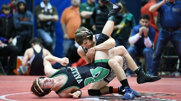 BCCA Holiday Tournament on Thursday, December 28, 2017, at Hackensack High School. (right) Antonio Abate, of Old Tappan, battles Jake Averna, of Pascack Valley, in their 113 pound match.