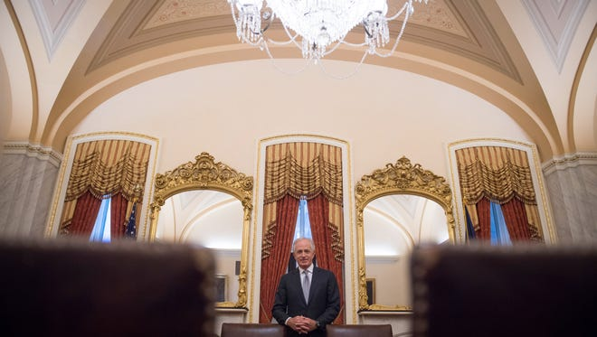 Sen. Bob Corker stands in the ceremonial Foreign Relations Committee room in the U.S. Capitol. As chairman of the Senate Foreign Relations Committee, he's pushed to hold foreign governments accountable for adverse actions — including Russia over election interference and later Saudi Arabia for its role in the murder of a Washington Post columnist.