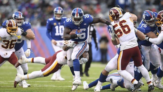 New York Giants running back Orleans Darkwa (26) rushing against the Washington Redskins in East Rutherford, NJ on Sunday, December 31, 2017.