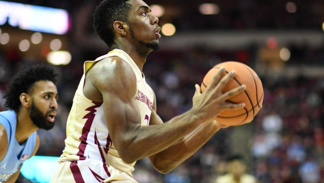 FSU sophmore guard Trent Forrest (3) shooting a layup during the first half of FSU's 81-80 victory over FSU.