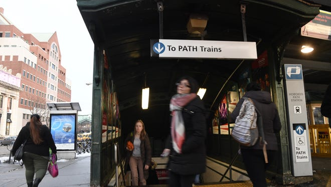 Evening commuters exit the PATH station in Hoboken, N.J. on Thursday, January 11, 2018.