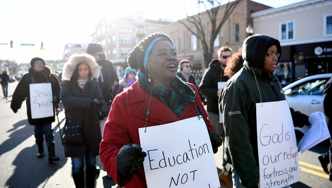 Deborah Moore of Hackensack marches down Palisade avenue during the annual Dr. Martin Luther King, Jr. march in Englewood, N.J. on Monday morning, January 15, 2018. Moore has marched on Martin Luther King, Jr. Day every year since she was 15 years old.