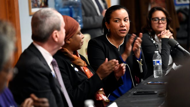 Executive Director of New Jersey Working Families Analilia Mejia, second from right, applauds Governor Phil Murphy during a roundtable discussion on minimum wage and paid sick leave in Newark, N.J. on Wednesday, January 17, 2018.