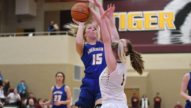 Aberdeen Central's Emma Yeske (15) takes a shot over Harrisburg's Kiki Berndt (1) during the match up of the two top-ranked teams in Class AA in Harrisburg on Tuesday night. Aberdeen Central won 46-41.