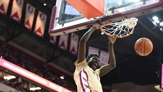 FSU's Christ Koumadje dunking the basketball aggresively during the second half in the heated rivarly against Miami.