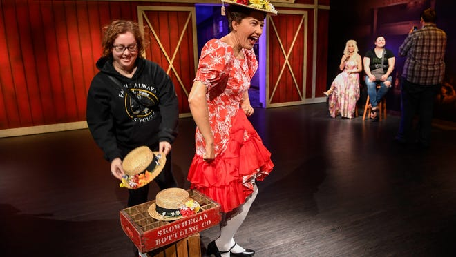 Aug 7, 2017; Nashville, TN, USA; Danielle Rossman from Nashville replaces one of Minnie Pearls hats after posing with her at the Madame Tussauds at the Opry Mills Mall. Mandatory Credit: Lacy Atkins/The Tennessean via USA TODAY NETWORK ORIG FILE ID:  20170809_gma_usa_010.jpg