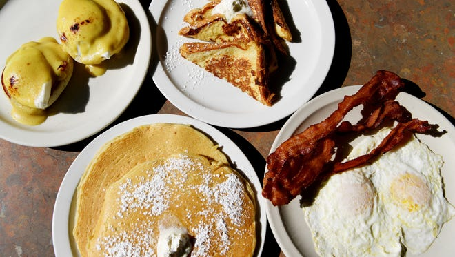 An array of breakfast items from JK's Kitchen, clockwise from left, eggs Benedict, french toast, JK breakfast combo and pancakes February 8, 2018 in Arden.