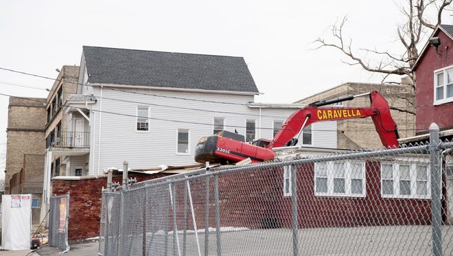 Demolition of 267 Fair Street, a vacant building that has been a notorious drug den in Paterson's 4th Ward for years, on Wednesday, February 14, 2018