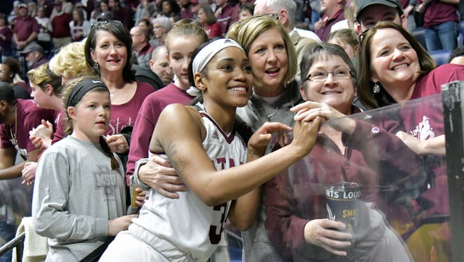 Mississippi State Lady Bulldogs guard Victoria Vivians (35) poses for a photo with fans after defeating the Texas A&M Aggies in semi final game one at Bridgestone Arena. Mississippi State won 70-55. Mandatory Credit: Jim Brown-USA TODAY Sports