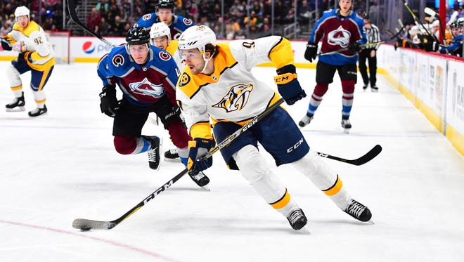 Mar 4, 2018; Denver, CO, USA; Colorado Avalanche defenseman Tyson Barrie (4) chases down Nashville Predators left wing Filip Forsberg (9) in the first period at the Pepsi Center.