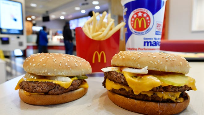 A McDonald's Quarter Pounder, left, and Double Quarter Pound burger is shown with fresh beef on March 6, 2018, in Atlanta.