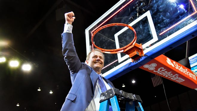 Middle Tennessee Blue Raiders head coach Kermit Davis reacts to his team winning the regular season CUSA championship after cutting down the net following the game against the Western Kentucky Hilltoppers at Murphy Athletic Center. Middle Tennessee won 82-64. Mandatory Credit: Jim Brown-USA TODAY Sports