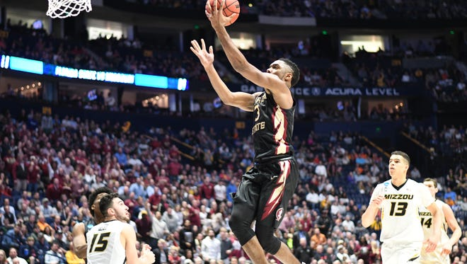 Sophomore guard Trent Forrest lays up for a field goal, propelling Florida State to a 67-54 victory over Missouri in the first round of the NCAA Tournament.